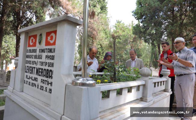GÜRKAN, ŞEHİT MERABAŞI'NIN KABRİNİ ZİYARET ETTİ